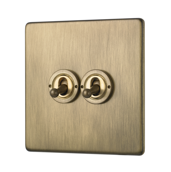 Penthouse double 2-way toggle switch in burnished brass