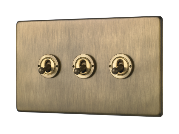 Penthouse triple 2-way toggle switch in Burnished Brass