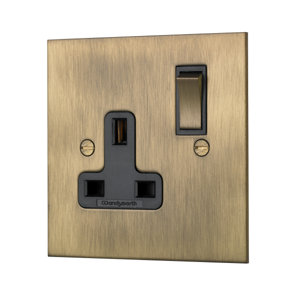 Classic square edge single switched socket in burnished brass